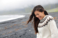 Cute woman walking on beach on Iceland royalty free stock photo