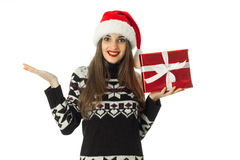 Cute woman in warm sweater and santa hat Stock Image