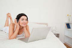 Cute woman watching a movie with her laptop Royalty Free Stock Photo