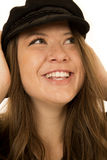 Cute woman wearing a black hat looking up smiling Stock Photography