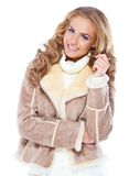 Cute woman wearing modern winter fur jacket Stock Photo