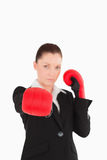 Cute woman wearing some boxing gloves Royalty Free Stock Images
