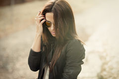 Cute woman wearing sunglasses outdoor Stock Images
