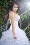 Cute woman wearing wedding dress stock images