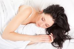 Cute woman on the white bed Stock Images