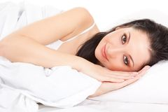 Cute woman on the white bed Royalty Free Stock Photos