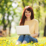 Cute woman with white laptop Royalty Free Stock Photography