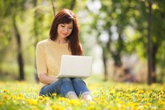 Cute woman with white laptop Royalty Free Stock Photo