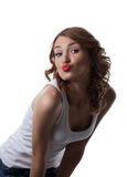 Cute woman in white tank top air kiss isolated Stock Photo