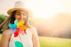 Cute woman with windmill Royalty Free Stock Photography