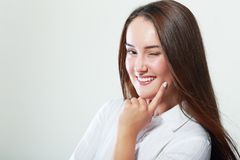 Cute woman winking Stock Image