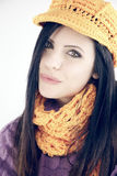 Cute woman in winter with hat and scarf looking camera Stock Photos