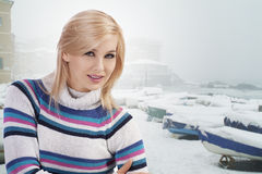 Cute woman with wool sweater posing towards camera Stock Photography
