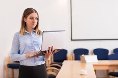 Cute woman working in the office Stock Image