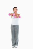 A cute woman working out with dumbbells Royalty Free Stock Images