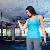 Cute woman working out with dumbbells Stock Photography