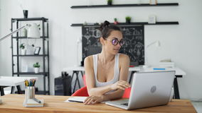 Cute woman working in trendy office stock footage