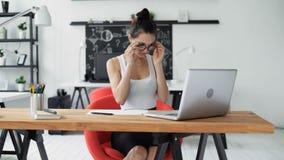 Cute woman working in trendy office stock video