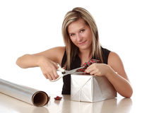 Cute woman wrapping a xmas gift Royalty Free Stock Image