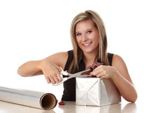 Cute woman wrapping a xmas gift Stock Image