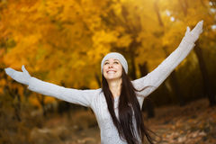 Cute woman in a yellow autumn park Royalty Free Stock Photos