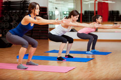 Cute women doing some squats Royalty Free Stock Image