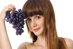 Cute woman with grapes Stock Photography