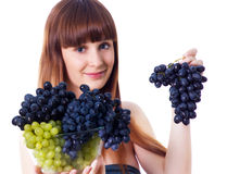 Cute women with a grapes Royalty Free Stock Photography