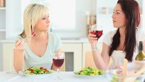 Cute women having dinner together stock video