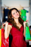 Cute women with packages shopping Royalty Free Stock Photos