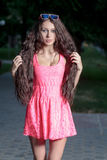 Cute women in pink dress Royalty Free Stock Image