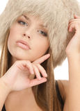 Cute women posing in fur cap Royalty Free Stock Photos