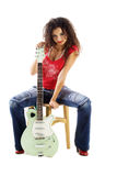 Cute woman in red with electric guitar Royalty Free Stock Image