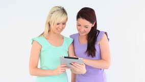 Cute women with a tablet Royalty Free Stock Image