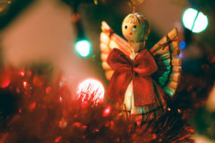 Cute wooden Christmas angel hanging in tree Royalty Free Stock Photo