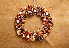 Cute wreath made of nuts and pine cones Royalty Free Stock Photography