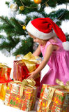 Cute xmas girl wihts gifts Royalty Free Stock Photos