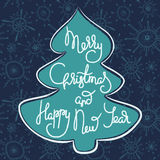 Cute xmas greeting card with fir tree. Cute xmas greeting card with green fir tree shape and white lettering on a decorative ornate blue background with hand Stock Photography
