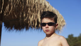 Cute 5 year old Caucasian boy poses on a beach Stock Images