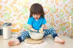 Cute 2 years boy baking at home kitchen Royalty Free Stock Images
