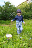 Cute 2 years boy plays ball outdoors in summer Stock Photo