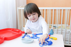 Cute 2 years child plays doctor Royalty Free Stock Photography