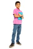 Cute black boy with tablet pc. Cute 10 years old black boy standing with tablet computer, full height, isolated on white Royalty Free Stock Photos