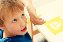Cute 6 years old boy Stock Images