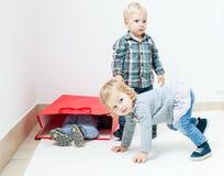 Playful children in room Stock Photo
