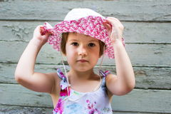 Cute 3 years old girl against vintage backdrop royalty free stock photo
