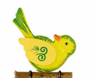 Cute yellow bird carved of wood Royalty Free Stock Images