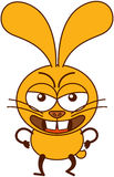 Cute yellow bunny in an angry attitude Stock Image