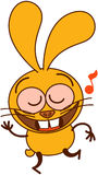 Cute yellow bunny dancing and singing animatedly Royalty Free Stock Photo
