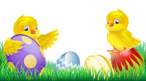Cute yellow chicks and Easter eggs Stock Photography